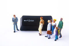 Enter. Miniatures with the enter button of a keyboard Royalty Free Stock Photography