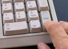 Enter. Closeup of finger pressing the ENTER key stock photography