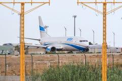 Enter Air jet entering runway Stock Photo