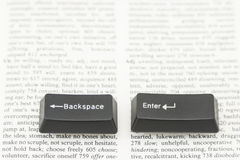 Enter and Backspace Computer Keys on a Book Page Stock Photography