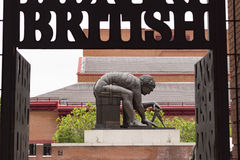 Enter the British Library. London, England - May 19, 2016: Entrance Gate of the British Library and Statue of Isaac Newton by Eduardo Paolozzi in London, England Stock Photos