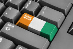 Enter button with Ivory Coast Flag Stock Photography