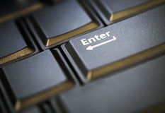 Enter button in low key Stock Images