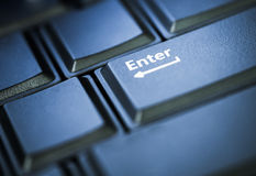 Enter button in low key Royalty Free Stock Photo