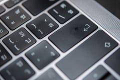 Enter button on notebook keyboard. Laptop, closeup Royalty Free Stock Image