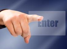 Enter button on the virtual screen. Hand pressing enter button on the virtual screen stock photography