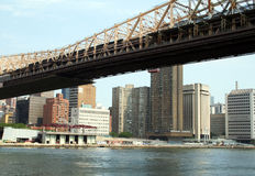 Enter The Corporate World. Queensboro Bridge going into Manhatten, with large skyscrapers in the background stock images