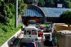Enter of cross sea tunnel, Hongkong 2016. Entry of cross sea tunnel and traffic in Hongkong, shown as city environment and  transportation, and people business Stock Photo