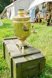 Samovar (fire pot) for morning tea at Russian army Royalty Free Stock Photography