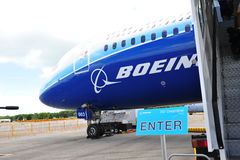 Enter dream tour signage beside Boeing 787 Dreamliner at Singapore Airshow 2012 Royalty Free Stock Images