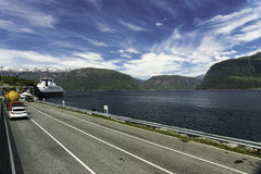 Enter the Ferry. Some cars are waiting for a ferry in Norway Royalty Free Stock Image