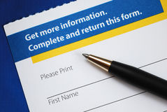 Enter the form to request more information. Isolated on blue Royalty Free Stock Photos