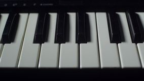 ENTER AND GO LIGHT ON THE KEYBOARD. OF A PIANO stock footage