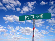 Enter Here. Sign that reads Enter Here Royalty Free Stock Photo