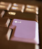 'Enter' key. A close-up shot of the 'Enter' key of a laptop with a shallow focus on the arrow Stock Photography