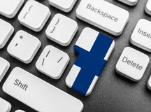 Enter key button with Flag of Finland. Close-up Royalty Free Stock Image