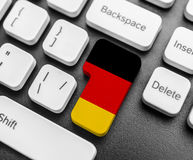 Enter key button with Flag of Germany. Stock Images