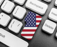 Enter key button with Flag of USA. Close-up Stock Images