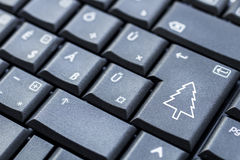 Enter key for a Christmas tree Royalty Free Stock Photo