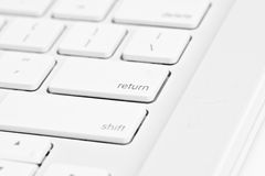 Enter key on a computer. White mac Royalty Free Stock Photography