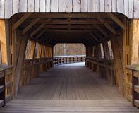 Enter and Pass. The entrance to a covered bridge stock image