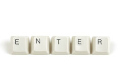 Enter from scattered keyboard keys on white Royalty Free Stock Image