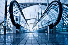 Enter to blue travolator in modern airport Stock Photo