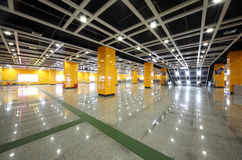 Enter to metro in Southern train station. GUANGZHOU - NOV 25: Enter to metro in Southern train station with yellow column on Nov 25, 2011 in Guangzhou, China. In Royalty Free Stock Image