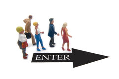 Enter to the Right. Miniature figures with an arrow pointing to the right Royalty Free Stock Images