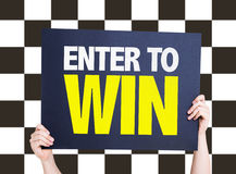 Enter to Win card with checkered flag on background Stock Photos