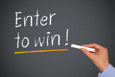 Enter to win on chalkboard Royalty Free Stock Photography