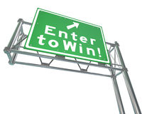 Enter to Win Words Green Freeway Sign. The words Enter to Win on a green freeway road sign to illustrate buying tickets for a lottery or betting in a casino or Royalty Free Stock Images
