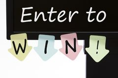 Enter to Win Concept. Enter to Win! written on color stickers in computer display isolated on white background stock photo
