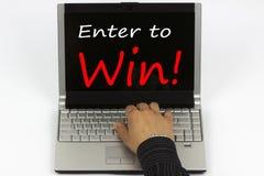 Enter to Win written on laptop screen. Enter to Win! written on laptop screen.Hand of a man on a keyboard Stock Photo