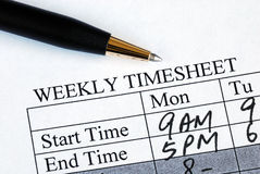 Enter the weekly time sheet Stock Image