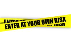 Enter at your own risk yellow caution tape Stock Image