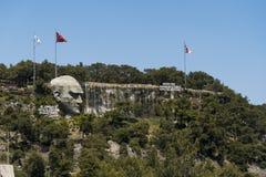 Enterance of the Antalya city. Antalya, Turkey - April 22, 2018: Enterance of the Antalya city with an artificial waterfall, flags and a statue of Mustafa Kemal stock photos