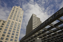 Enterance to Potsdamer Railroad station. Enterance to Potsdamer Platz U-Bahn station in Berlin with skyscrapers in background Royalty Free Stock Photography