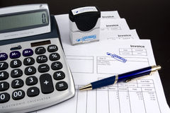 Entered Invoice with Calculator and Pen. Stack of Entered Invoices with Calculator and Pen Royalty Free Stock Photo