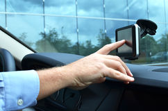 Entering an address into the navigation system. Driver entering an address into the navigation system Royalty Free Stock Photo