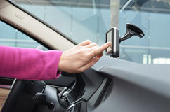 Entering an address into the navigation system. Driver entering an address into the navigation system Stock Images