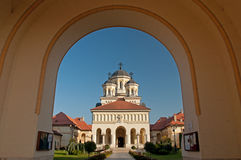 Entering the Alba Iulia Citadel. The Union Cathedral of Alba-Iulia, as seen from the citadel gateway. Built between 1921 and 1922 inside the medieval fortress stock photo
