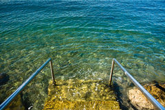 Entering beautiful crystal clear adriatic sea in summer stock photo