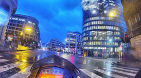 Entering the city on a wet morning on a motorcycle Royalty Free Stock Image