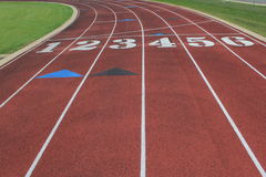 Entering the curve. A six lane track for running Royalty Free Stock Photos