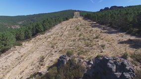Entering firebreak, aerial view with pine tree forest and rock. Aerial view of firebreak between pine tree forest in the mountain, 4K stock video