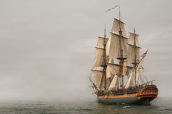 Entering Fog. Vintage Frigate sailing into a fog bank