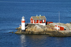 Entering Gothenburg harbour. When entering Gothenburg harbour, one of the first things you see is this small house build on some granite cliffs in the water stock image
