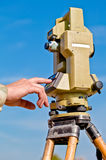 Entering information into theodolite Stock Photography