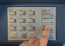 Entering nip code numbers in cash machine by pressing buttons Royalty Free Stock Images